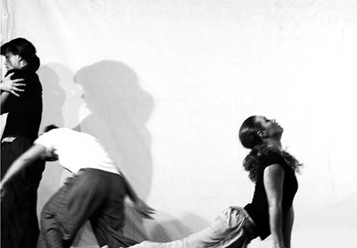 three dancers performing contemporary dance