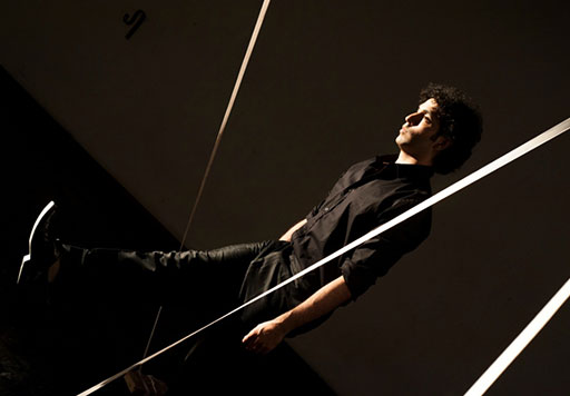 moving between large strings suspended in the performance space