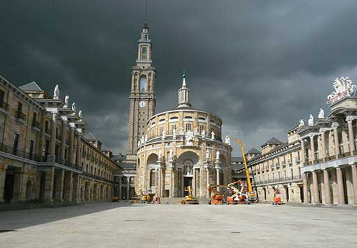 Dark storm clouds fill the sky behind Laboral church and forecourt.