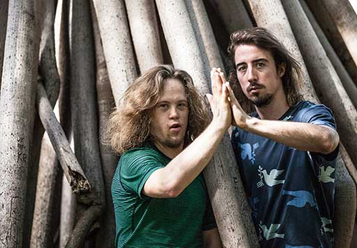 Dancenorth's Kyle Page and Chris Dyke in front of a fig tree's giant roots.